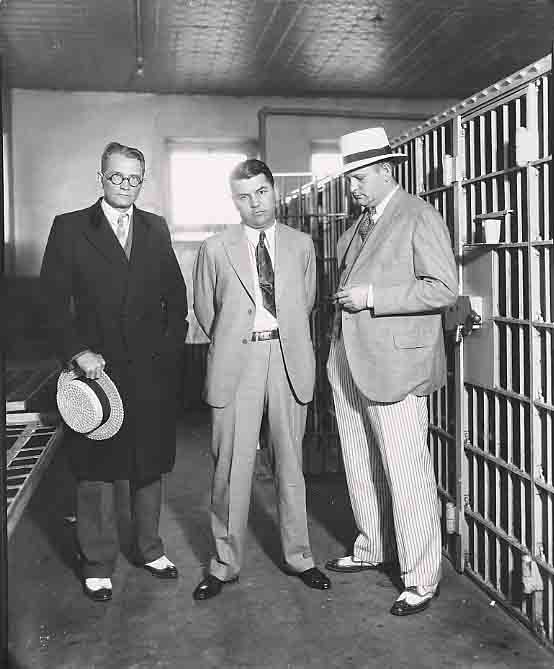 Men stand outside jail cell