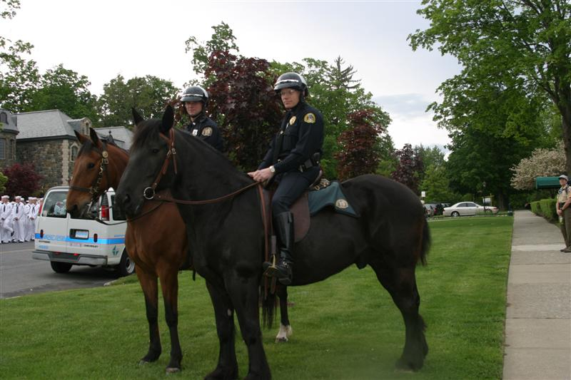 Officers ride horses down street